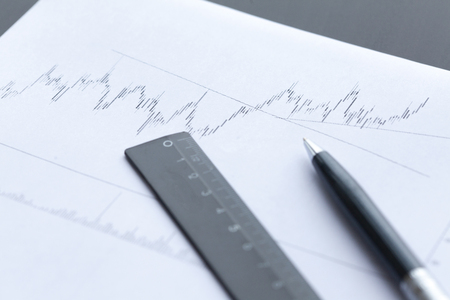 Chart on paper with office supplies. Internal inspector sum check, investigation exchange market earnings savings loan and credit concept Stock Photo