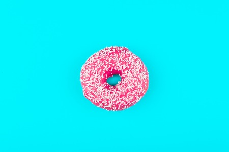 one pink isolated donut on a mint background