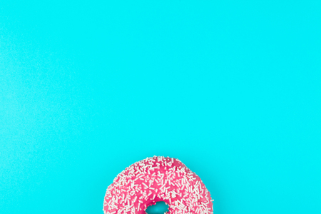 One pink isolated donuts on a mint background Stock Photo