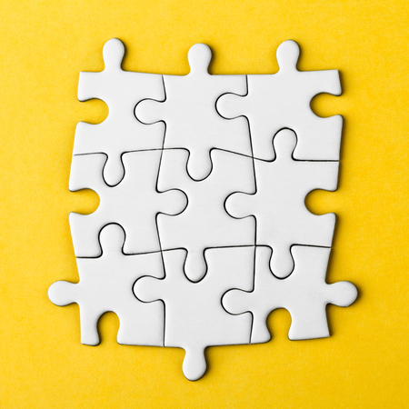Connected blank puzzle pieces Stock Photo