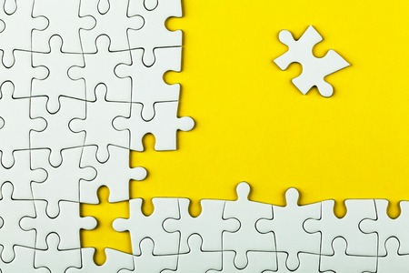 White details of puzzle on yellow background.