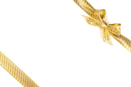 Gold bow tied using silk ribbon