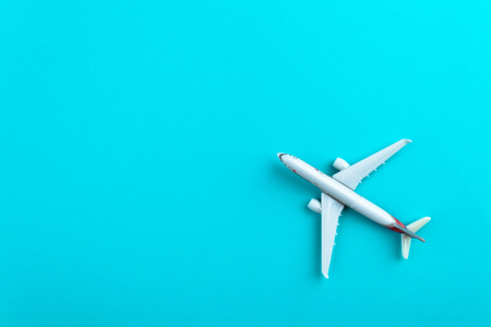Airplane on blue pastel color background. Stock Photo