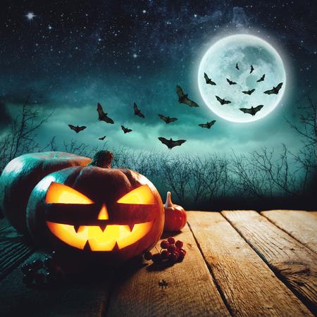 Halloween Pumpkin in Dark Forest. Halloween Background Stock Photo