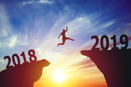 Silhouette of man jumping from 2017 to 2018 text Stock Photo