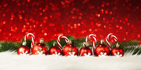 Red Christmas balls and candy decorations on lights background Stock Photo