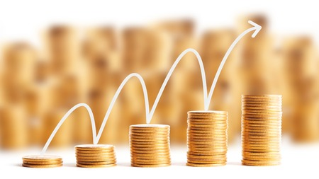 Rows of gold coins for finance and banking concept with Airrow graph