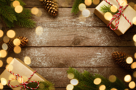 Christmas design - Merry Christmas. Xmas border with vintage gifts and decoration on old wooden background.