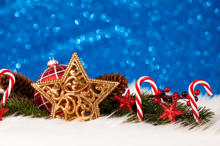 Christmas background with decoration on blue glitter background