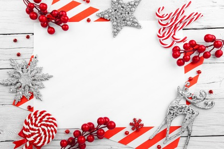 Red christmas frame with stars, snowflakes and candies Stock Photo