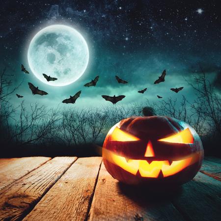 Halloween Scene - Jack Lanterns Glowing At Moonlight In The Spooky Night Stock Photo