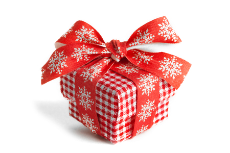 Christmas gift box with red ribbon isolated on white background Stock Photo