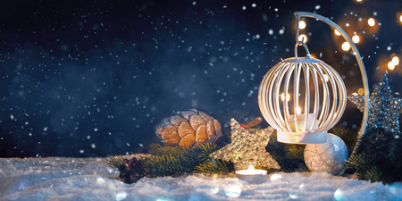 Christmas Lantern On Snow With decorations. New Years card