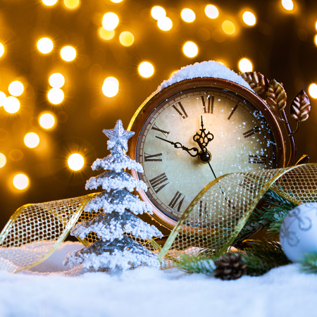 New Years clock with decoration on snow. Celebration Concept for New Year Eve. Stock Photo