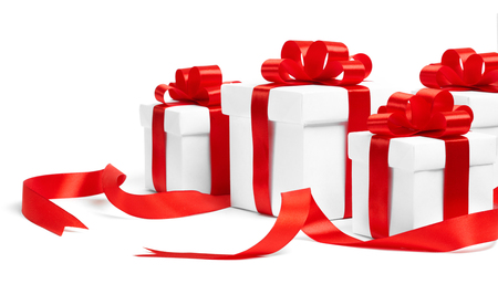 Christmas gift boxes with red ribbons on white background
