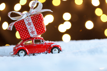 Christmas red car with gift box on snow Stock Photo