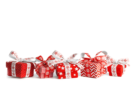 Different Christmas gift boxes and original ribbons Stock Photo