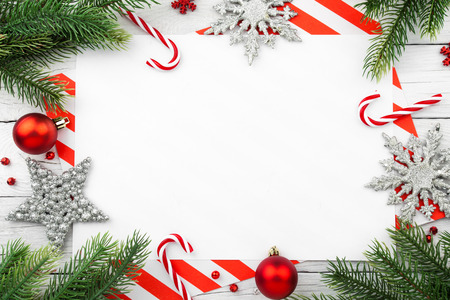 Christmas Border - tree branches with balls, candy and star Stock Photo