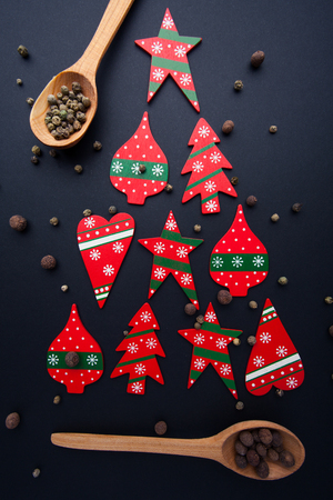 Christmas tree made from red candies and wooden spoons Stock Photo