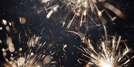 Christmas sparkler and smoke on black background