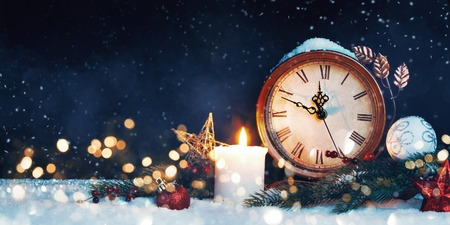 New Years clock. Decorated with balls, star and tree on snow