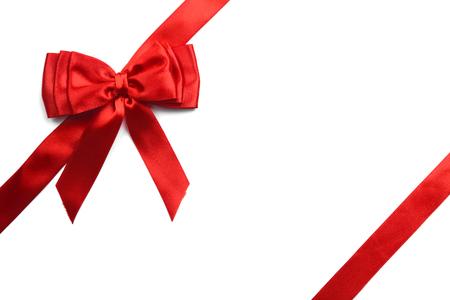 Shiny red satin ribbon on white background Stock Photo