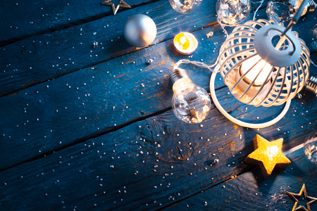 Christmas Lantern with decorations on blue wooden background