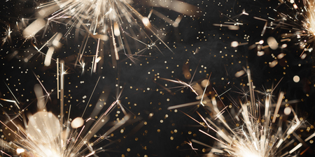 Christmas sparklers on black background Stock Photo