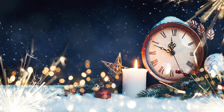 Christmas background. Christmas clock with snow.