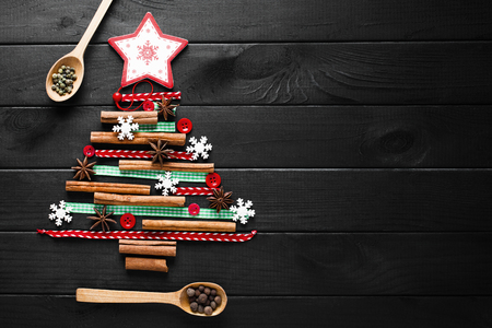 Christmas tree made of cinnamon, anise, ribbons and buttons Stock Photo