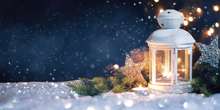 Christmas Lantern On Snow With decorations.