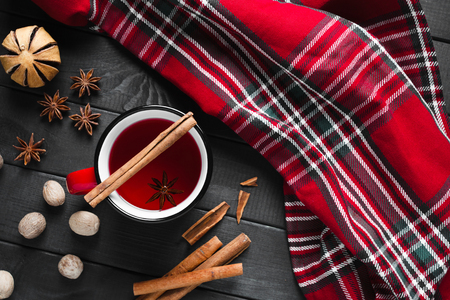 Glass of mulled wine with cinnamon and anise, top view