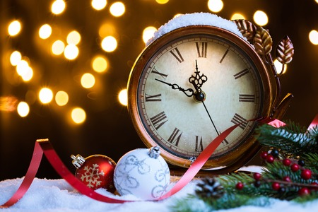 New Year, Christmas background. Christmas clock with snow.