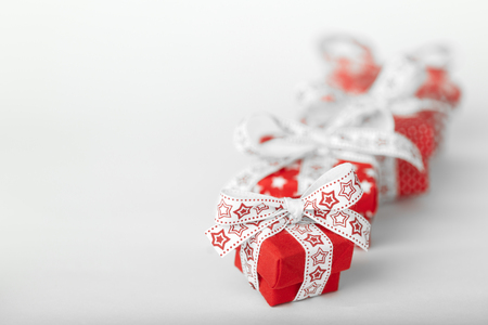 Red Christmas gift boxes on white background