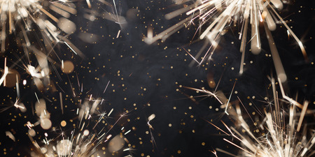 Burning christmas sparklers and smoke on dark background