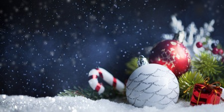 Christmas balls and decoration on snow. New Years card