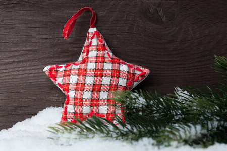 Christmas decoration on snow over wooden background Stockfoto