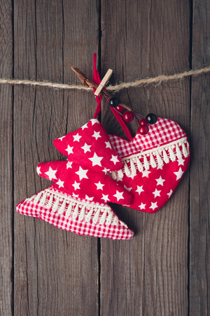 Christmas tree and heart toy on wooden background