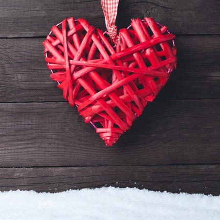 Heart over a wooden background. Valentines day greeting card Stockfoto