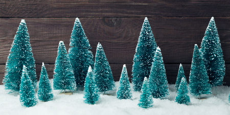 Christmas tree toys over wooden vintage background