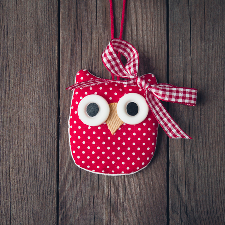 Christmas toy owl on a wooden background