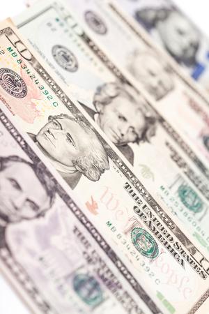 Row of US hundred dollar banknotes closeup