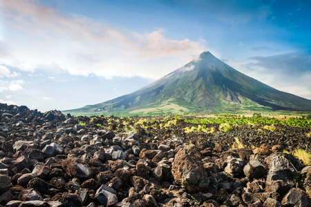 Mayon Volcano is an active stratovolcano in the Philippines. Stock Photo