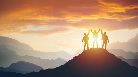 Group of peoples on mountains top in winner pose