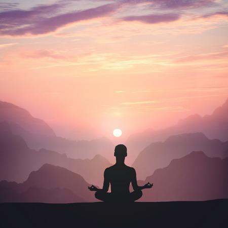 Man meditating on high mountain in sunset background Stockfoto