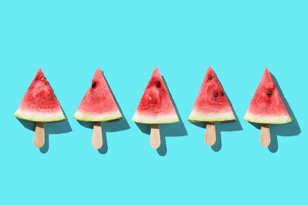 Piece of Watermelon on blue backgroud. Minimal style Фото со стока