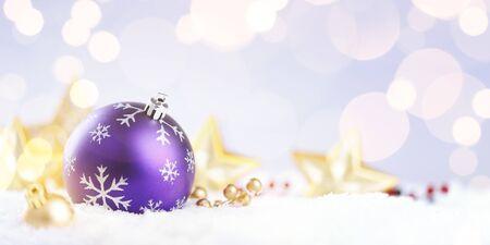 Purple christmas ball on a sparkle background, christmas time Фото со стока