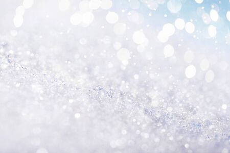 Chritmas light background with snow and blue sky. Design background