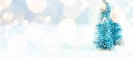 Christmas tree on snow with copy space. Happy New Year's card.