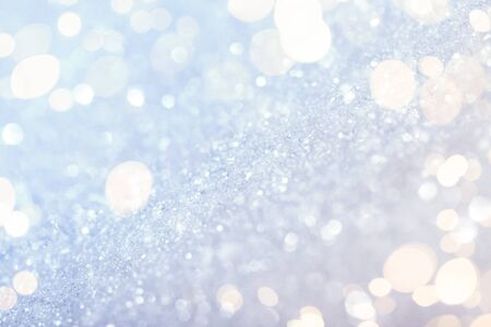 Chritmas light background with snow and gold lights. Design background